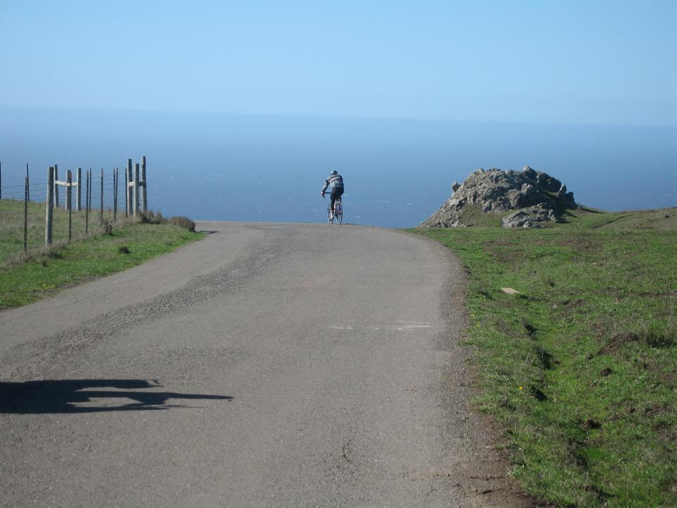 Winemaker Dan Goldfield rides his bicycle near the Pacific coast in Sonoma County.