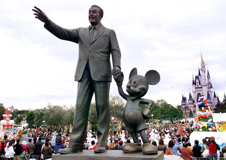 Walt Disney and Mickey Mouse statues stand at the