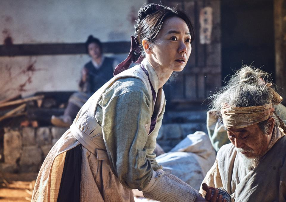 Bae Doona's character takes on zombies in the drama 'Kingdom.'
