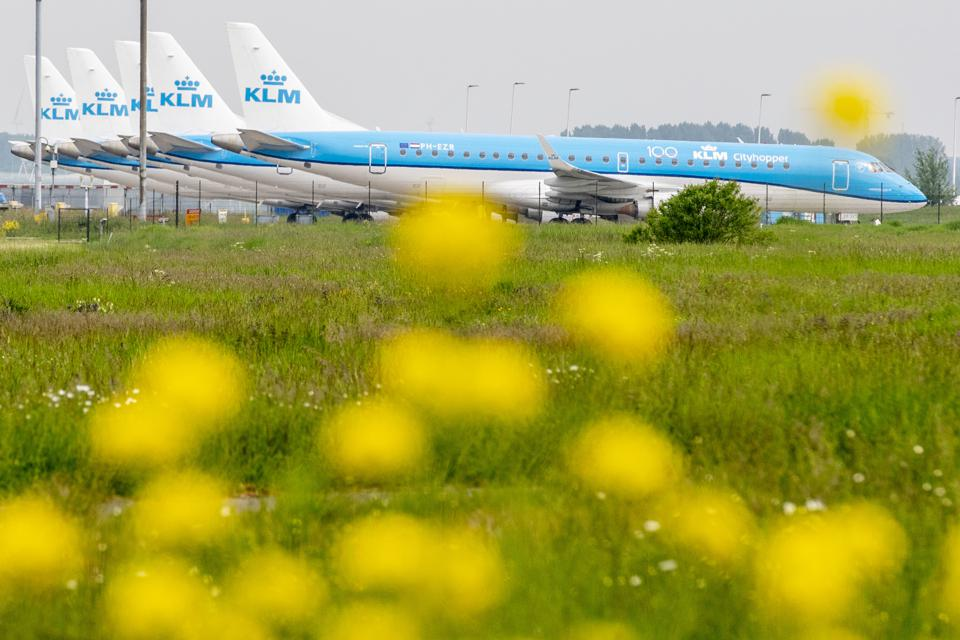 KLM Royal Dutch Airlines planes parked at Schiphol airport.