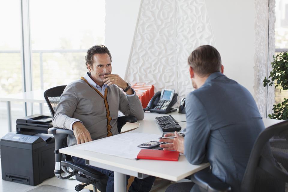 Business men talking in office