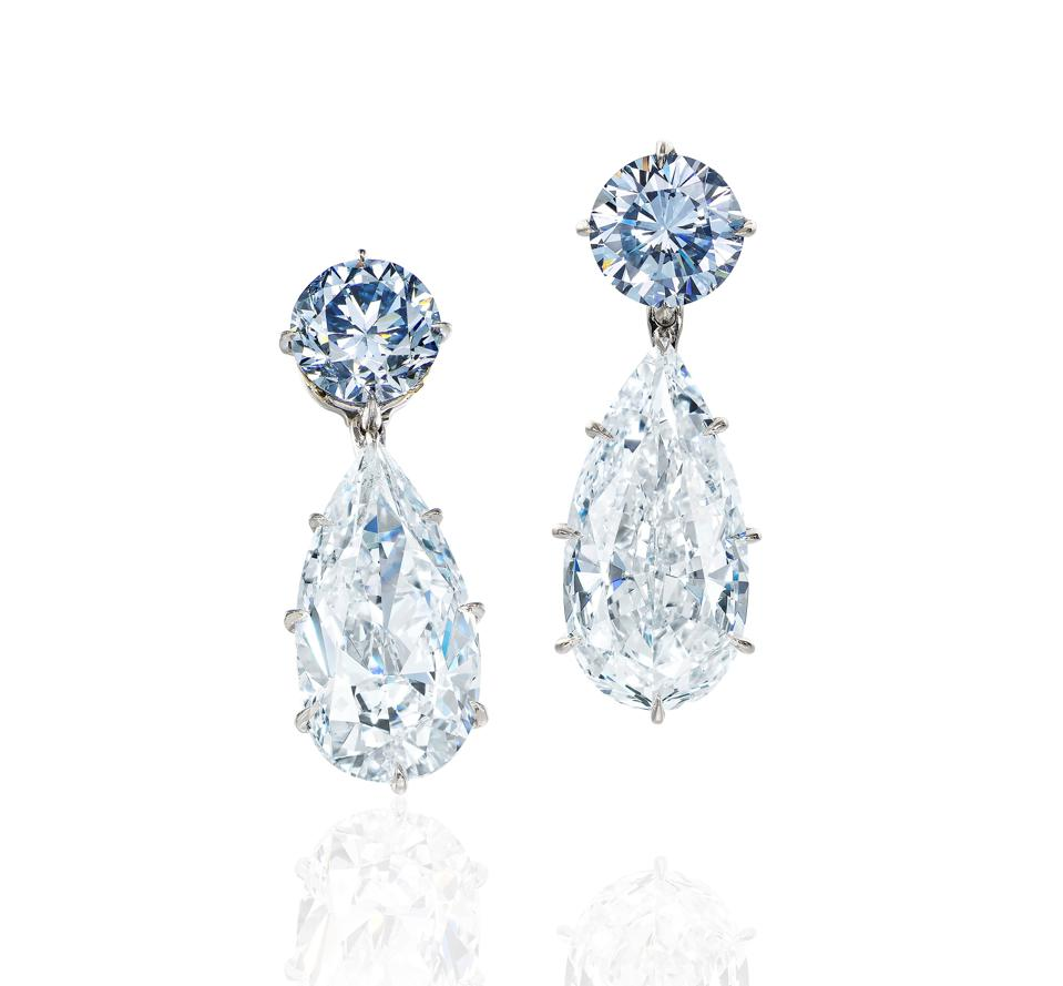 Collectors passed on these fancy intense blue diamond and diamond pendent earrings
