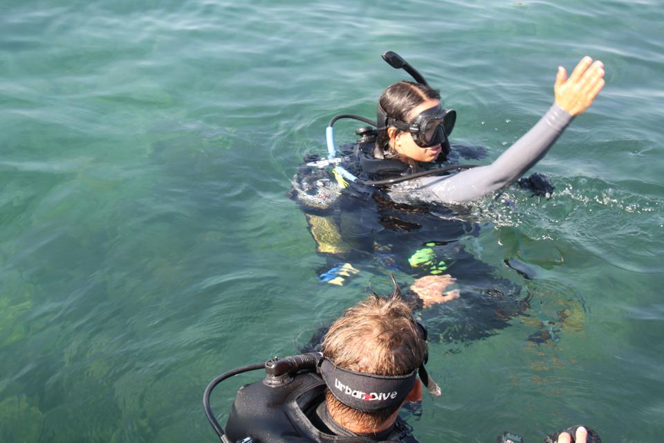 Jimena Golcher-Benavides and Chris Horsfall scuba dive off Tanganyika's Lake Shore lodge