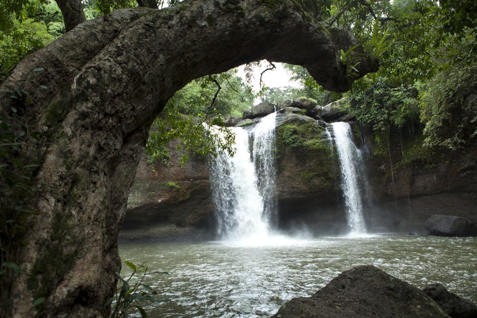 Haew Suwat Waterfall runs over a 20 meter cliff into a large...