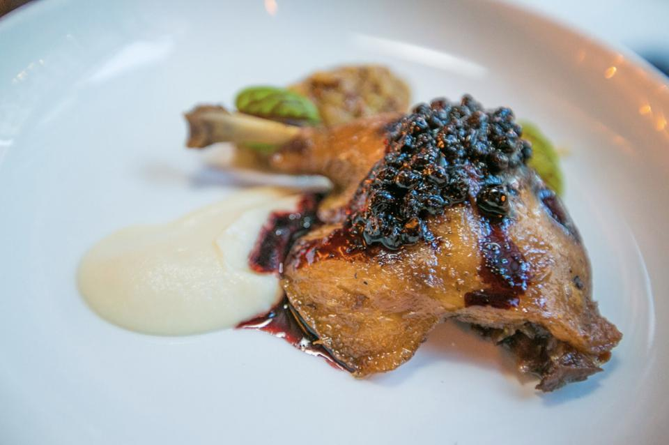 The duck leg confit blends the savory flavors of the duck and the fruity accent of the chutney and apple puree.
