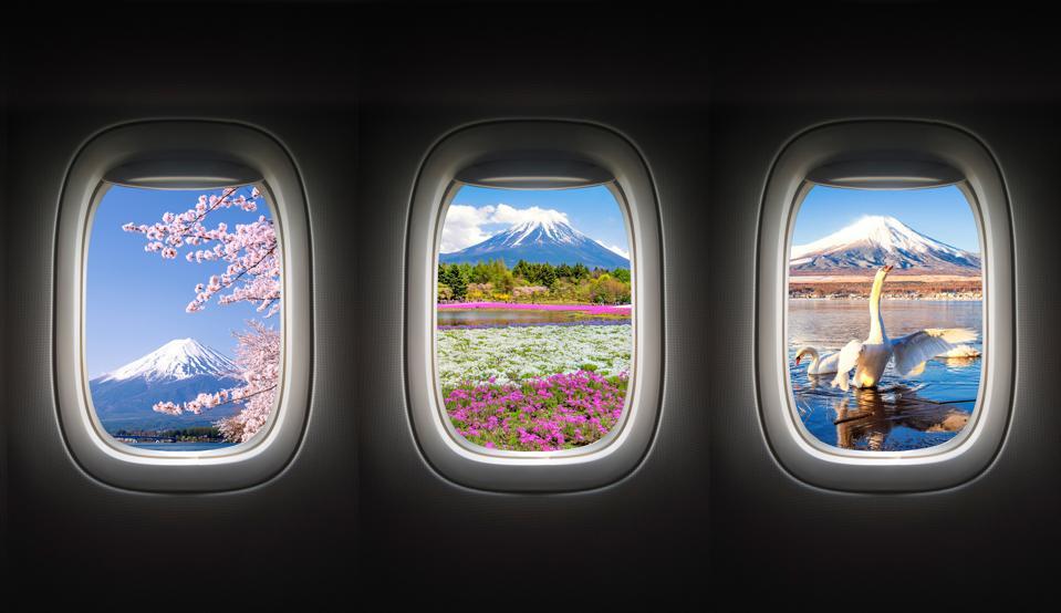 Fuji Mountain in Different Season from Airplane window, Japan