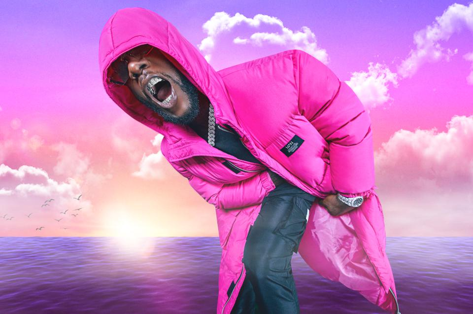 Burna Boy's pink puffer jacket for boohooMAN collection.