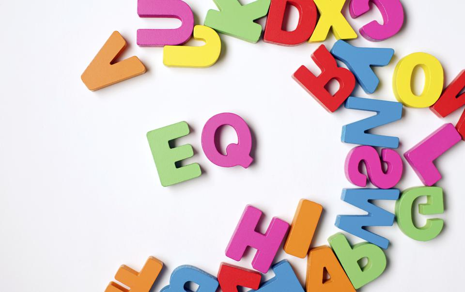 Colorful Wooden Word ' EQ '  or Emotional Quotient