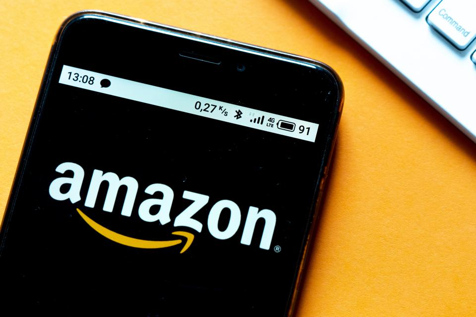 In this photo illustration an Amazon logo is seen displayed...