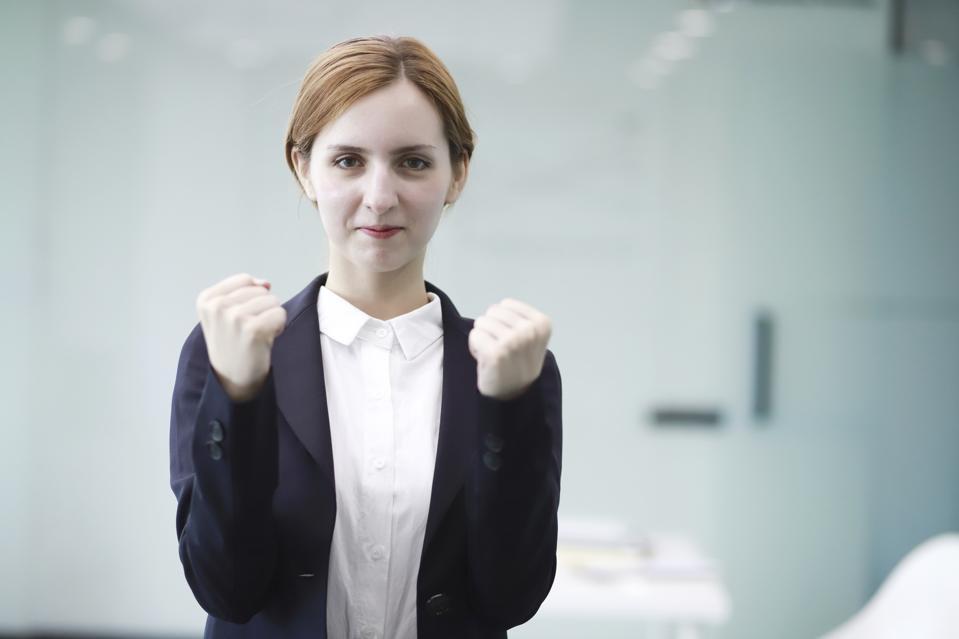 Portrait of businesswoman feeling accomplished