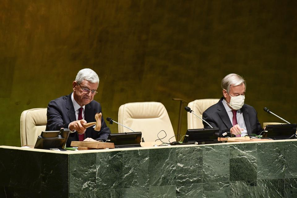 Volkan Bozkir, the President of the UN 75th General Assembly (left) and UN Secretary-General Antonio Guterres (right).