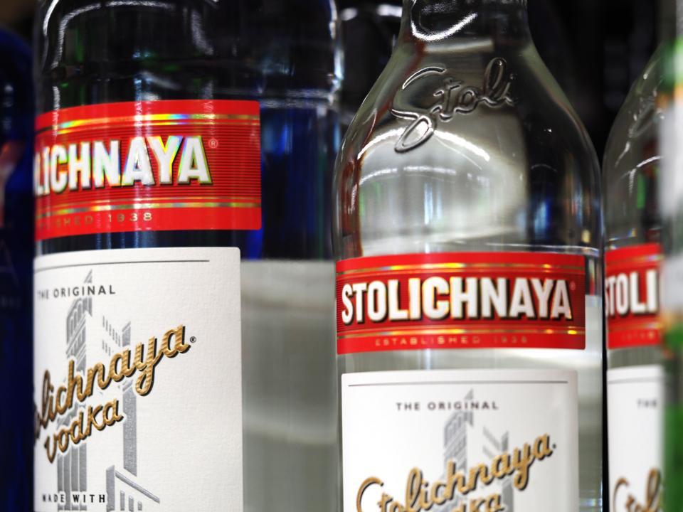 Bottles of Stolichnaya vodka seen displayed on shelves of...