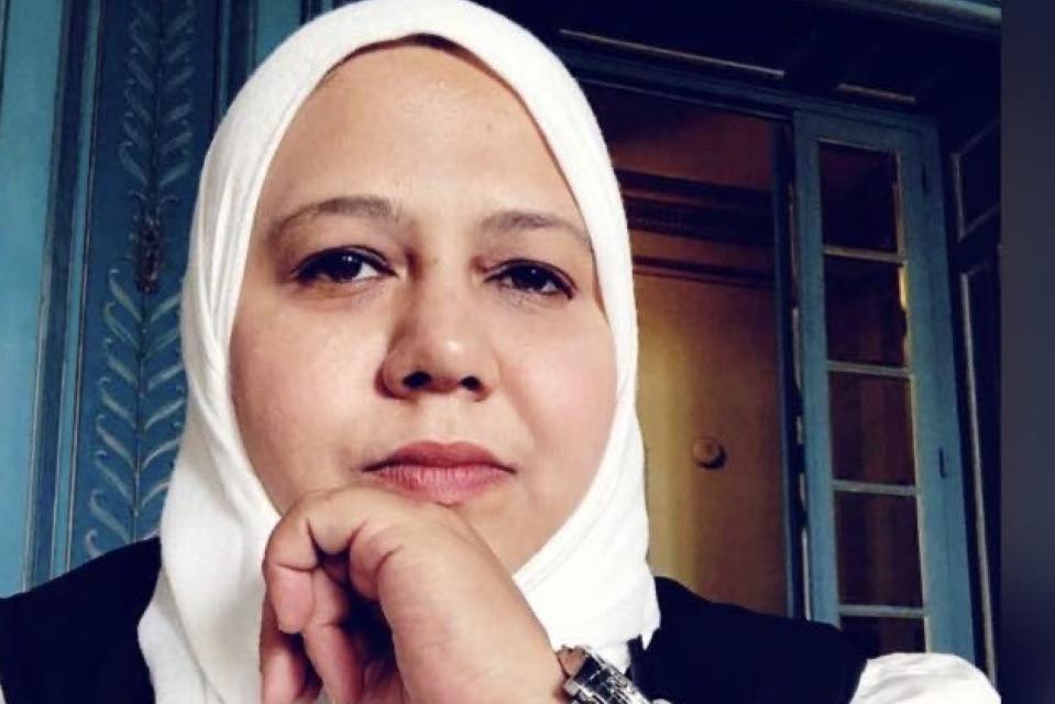 A  woman in a headscard - Muna Luqman