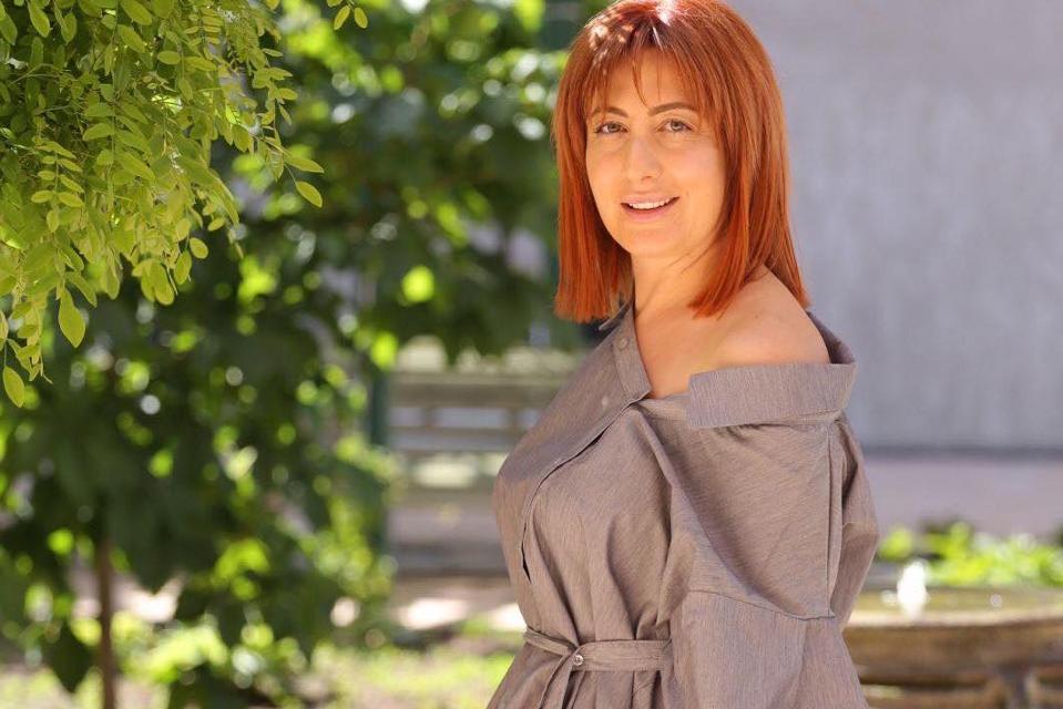Amalya Yeghoyan standing in a garden