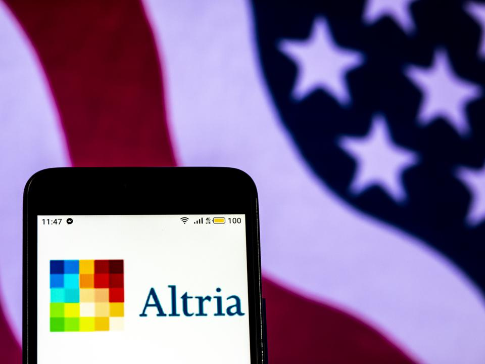 Altria Tobacco company logo seen displayed on a smart phone