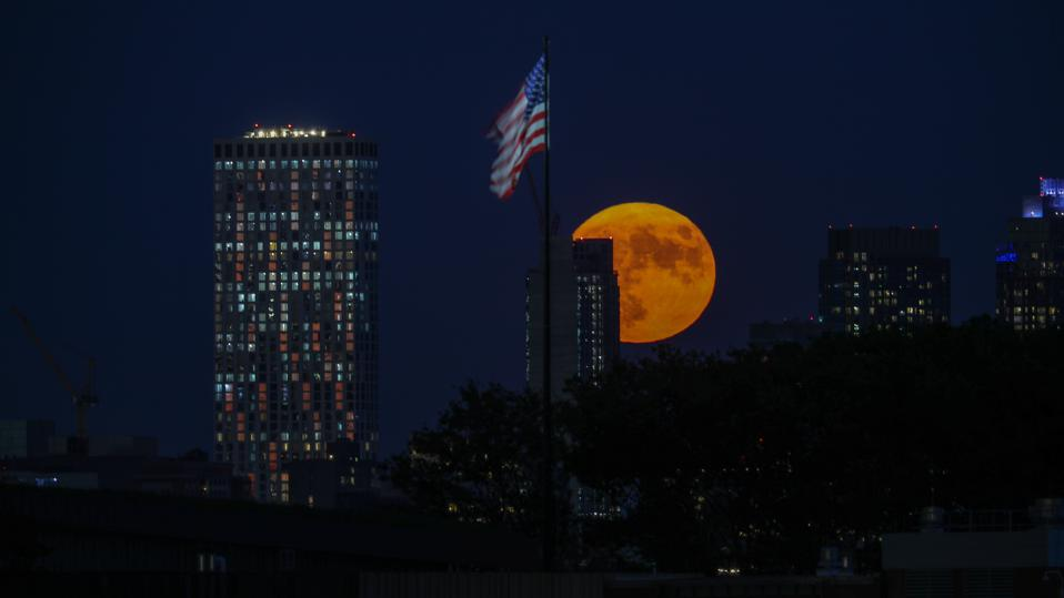Harvest Moon rises over the Statue of Liberty in NYC