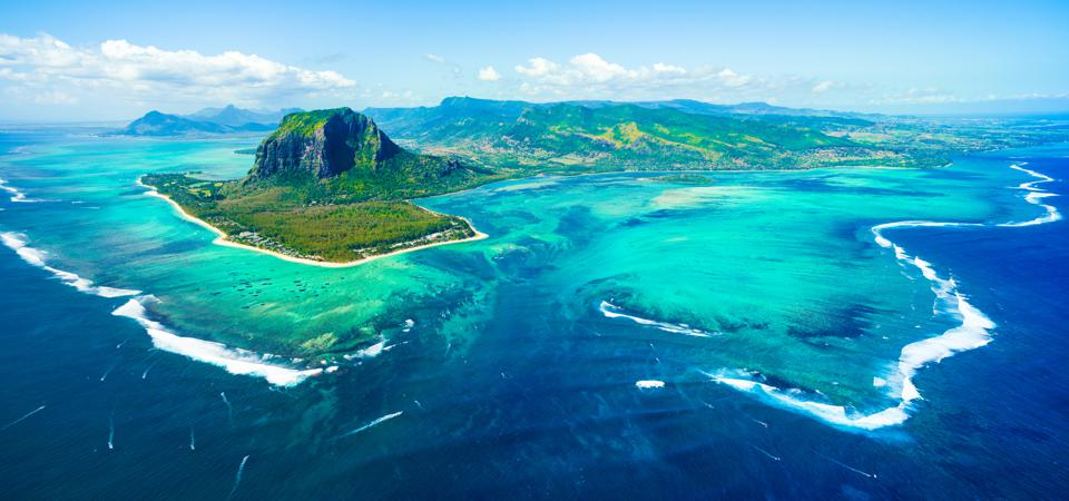 Aerial view of Mauritius and famous Le Morne mountain, coral  lagoon and 'underwater waterfall' optical illusion