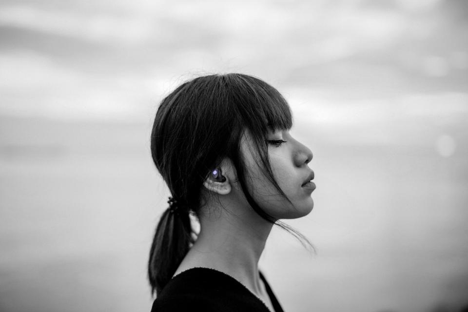 Woman wearing Grado GT220 true wireless earbuds