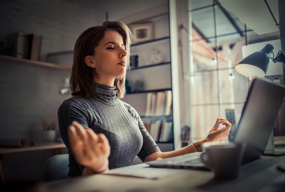 Woman in office meditating