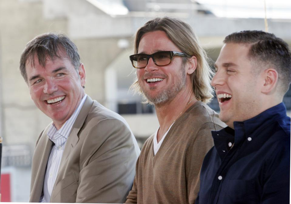 From left, Billy Beane, Brad Pitt, and Jonah Hill share a light moment as they  answer questions about the new movie ″Moneyball″  at the O.co Coliseum in Oakland, Calif. on Monday, Sept. 19, 2011.  (Laura A. Oda/Staff)