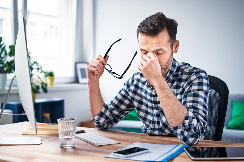Frustrated businessman working from home office.