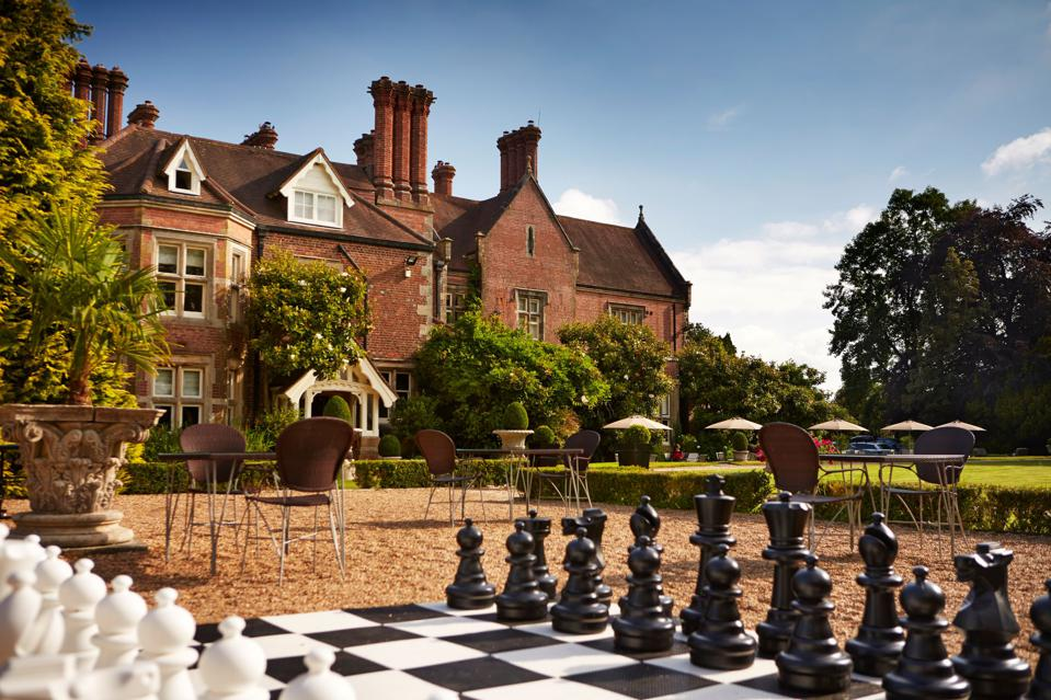 A giant outdoor chess set outside a British manor.