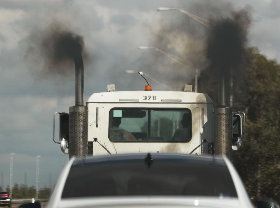 image of truck polluting the air