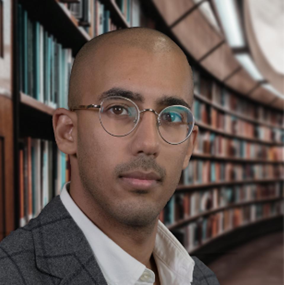 Headshot of author Basil Alomary