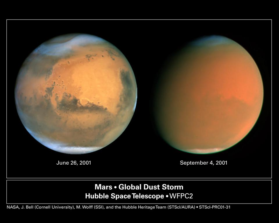 The before-and-after pictures, from Hubble, of the 2001 dust storm on Mars.