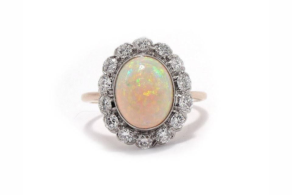 Ashley Zhang Diamond Halo ring in platinum and 18K yellow gold with an approximately 3-carat Australian opal and 0.50 carats diamond, $3,200, ashleyzhangjewelry.com