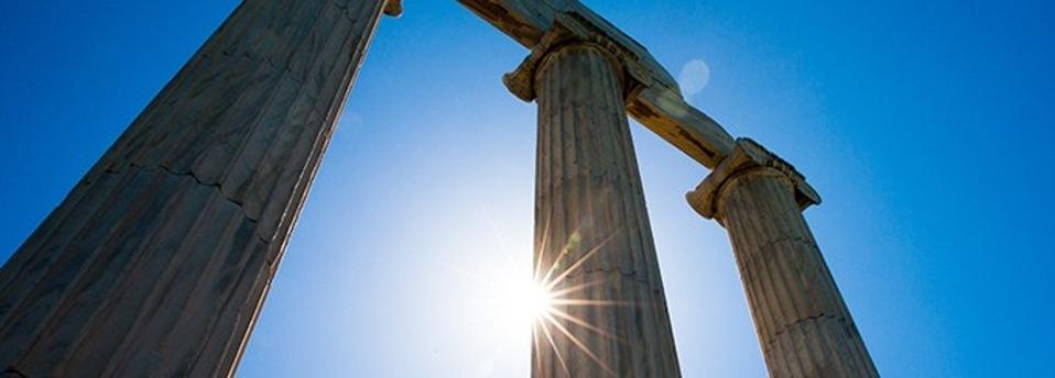 Sun gleaming through columns