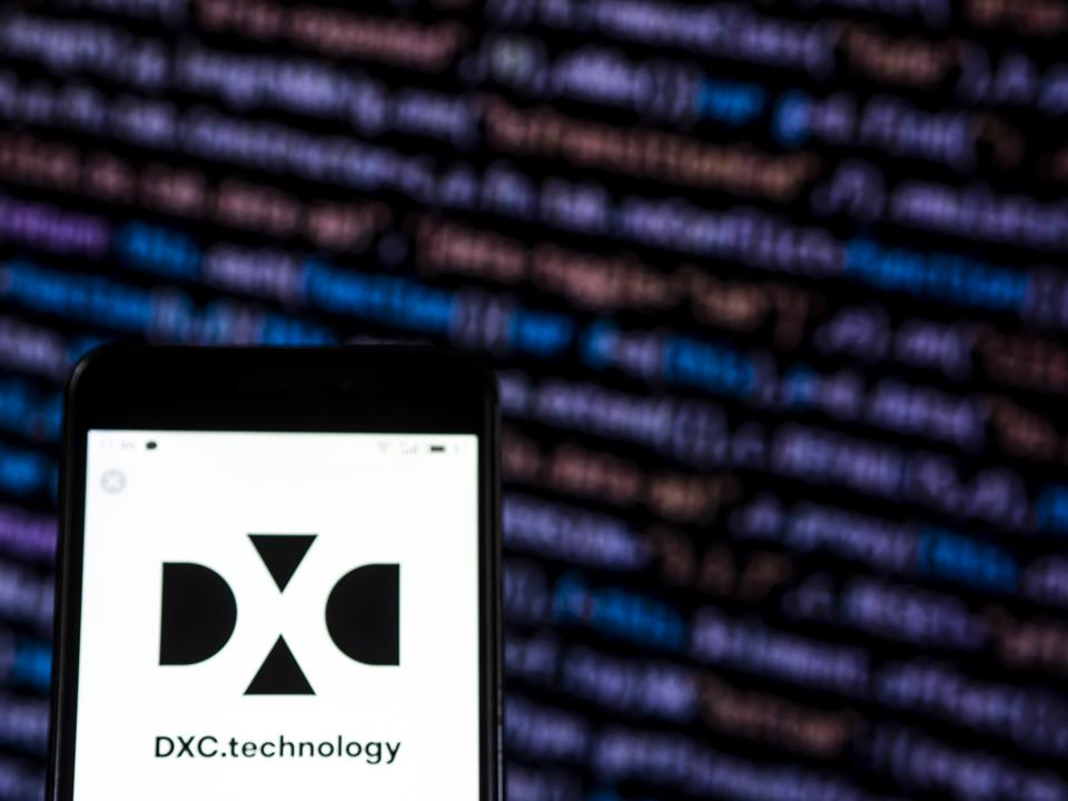 DXC Technology Company logo seen displayed on smart phone