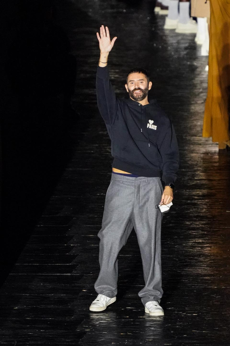 Ami's Alexandre Mattiussi greets guests at the end of his runway collection
