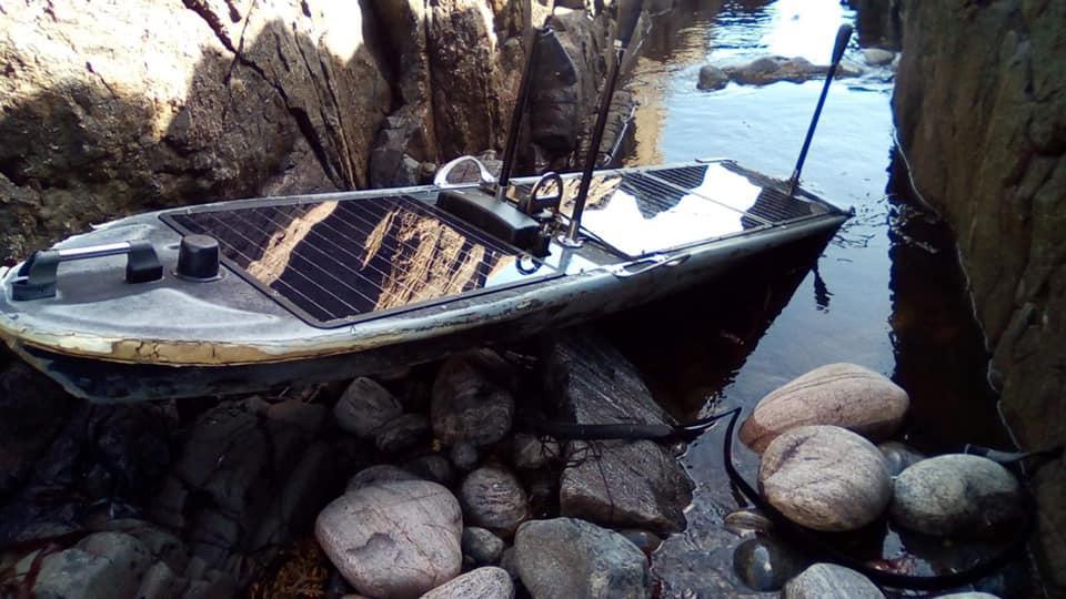Robot boat on rocky beach