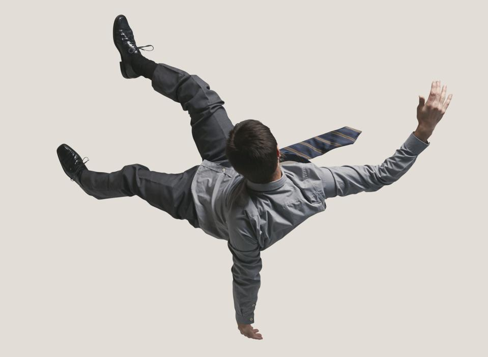 Young businessman in the air, falling down