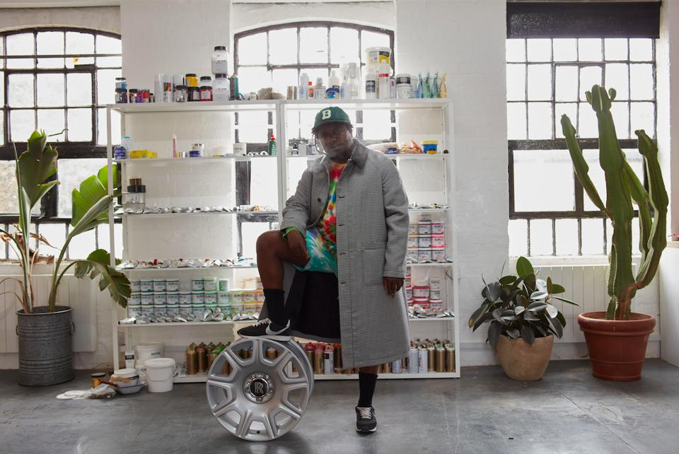 Artist stands in their studio with their art for Frieze Art Fair London