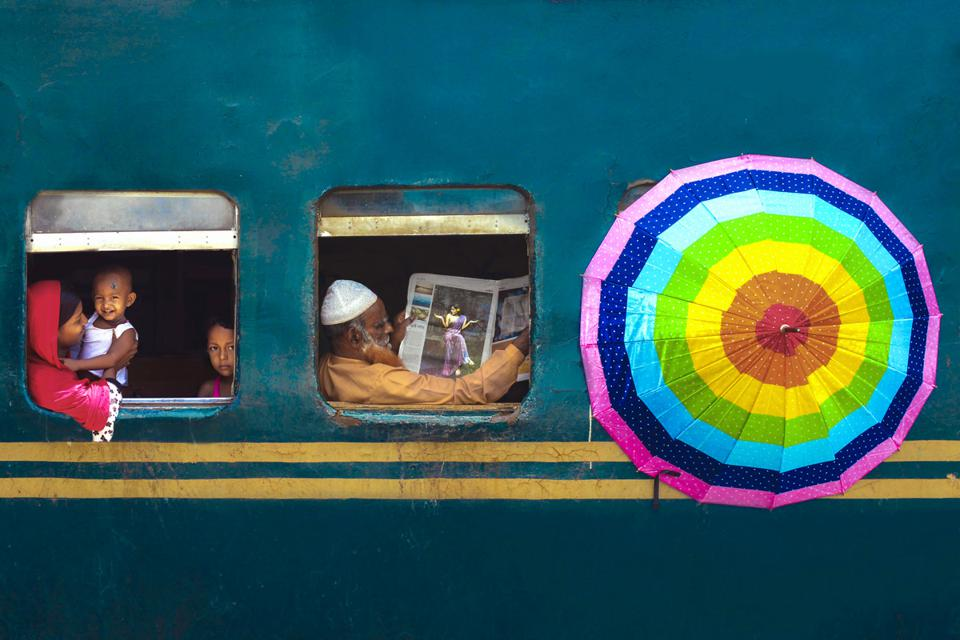 Independent Photographer winner: Passengers seen through the windows of a train in Bangladesh