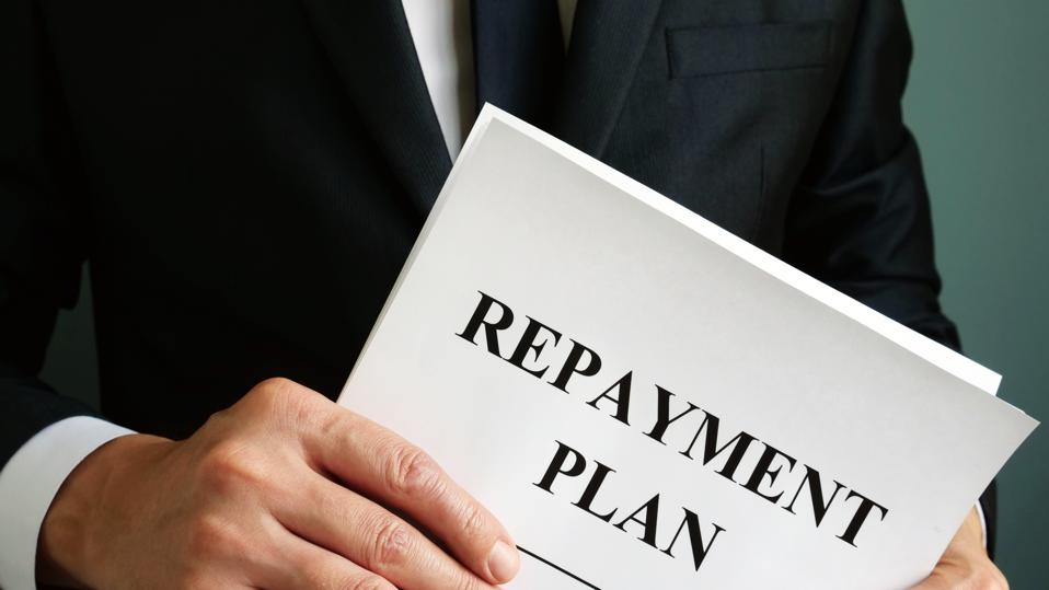 Repayment Plan that the man holds.