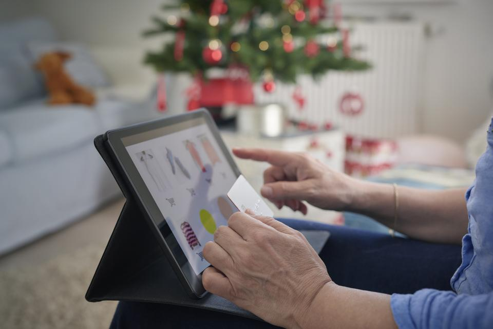Woman ordering Christmas gifts online