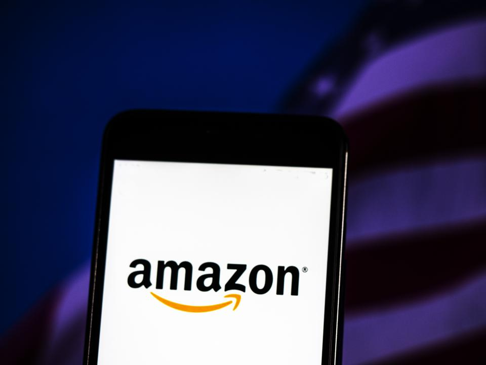 The Amazon logo seen displayed on a smart phone with a