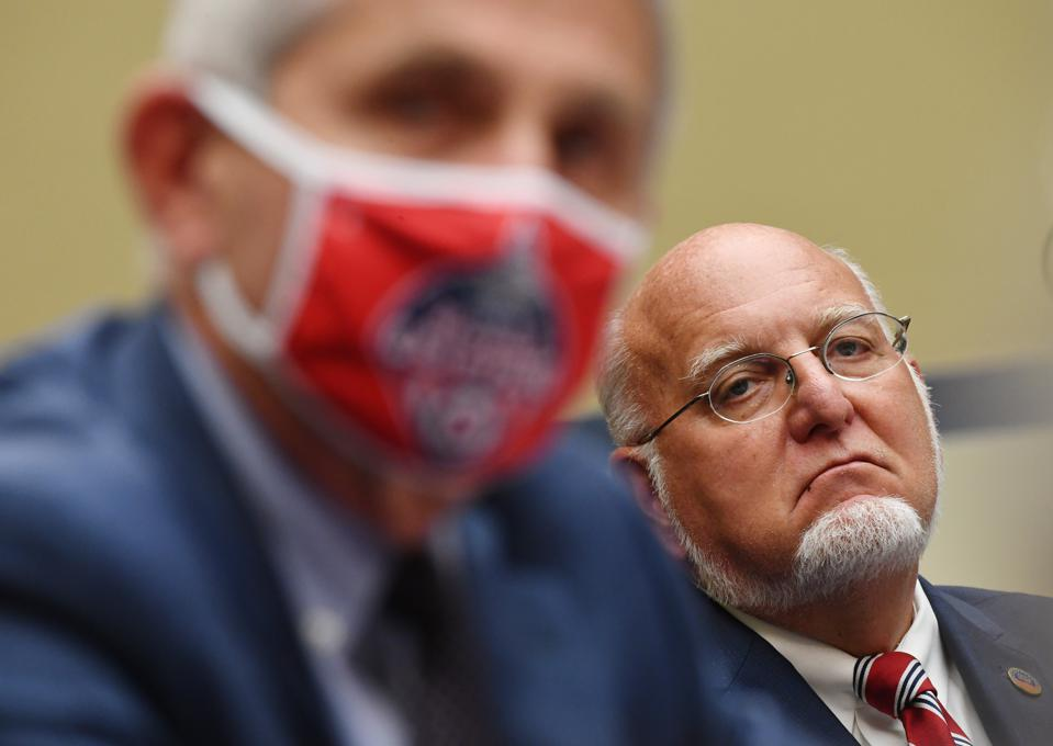 Dr Fauci wears a mask, Dr Redfield does not.