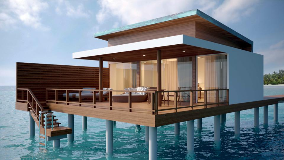 A sleek, modern villa suspended over the water