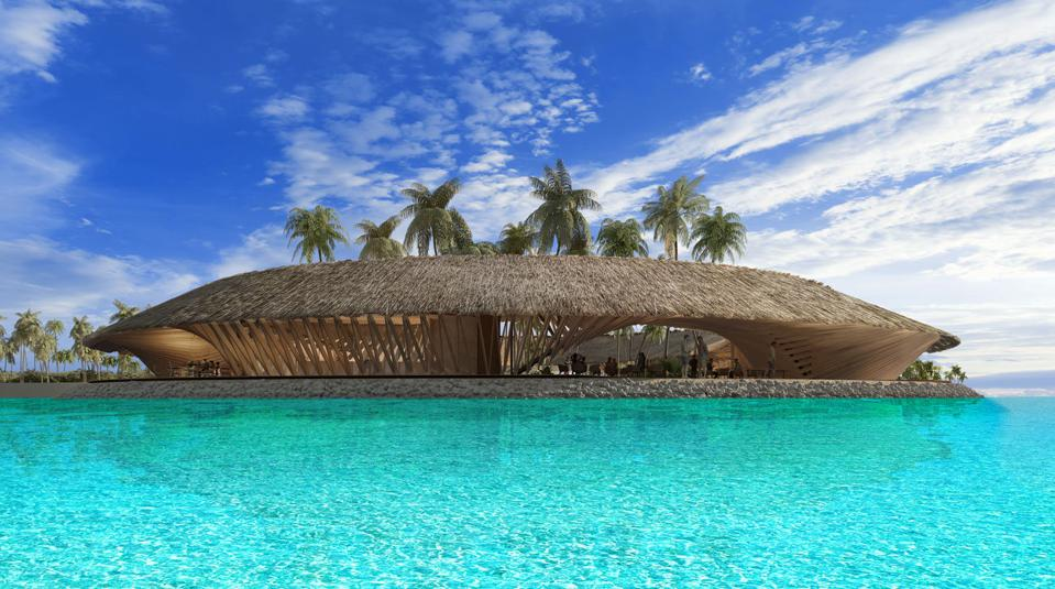 An oval structure surrounded by turquoise water
