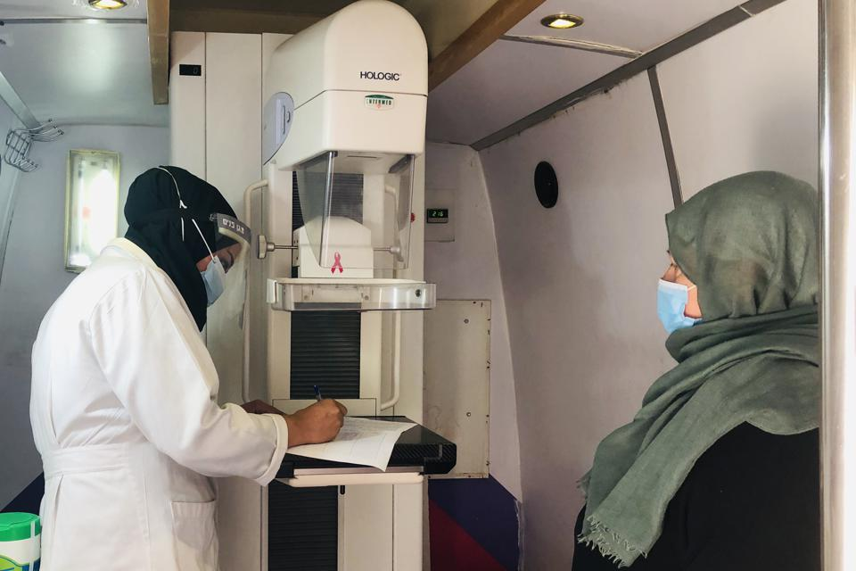 A mammography clinic with a nurse and a patient
