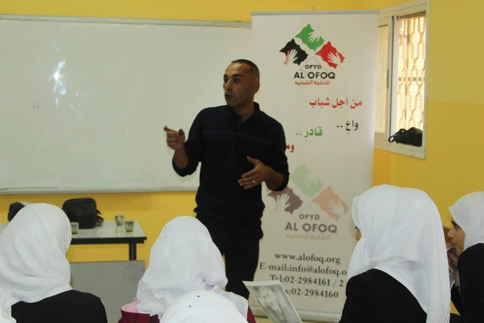 Amer El Fararjah standing up giving a presentation