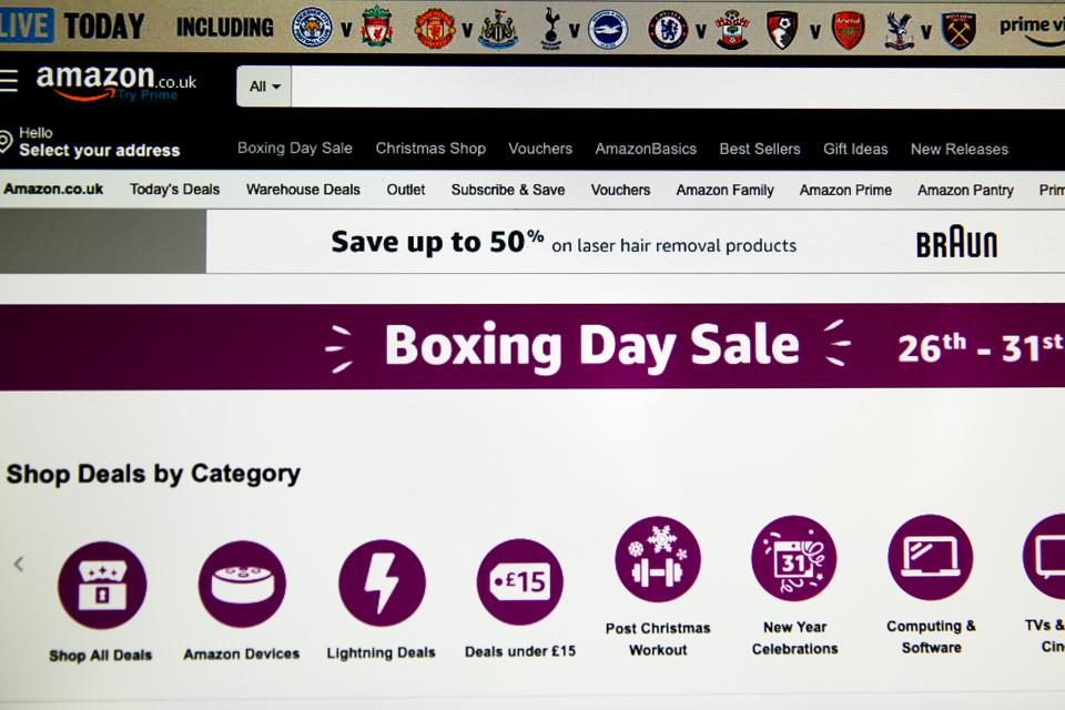 Home page of Amazon is seen on a computer as online Boxing...