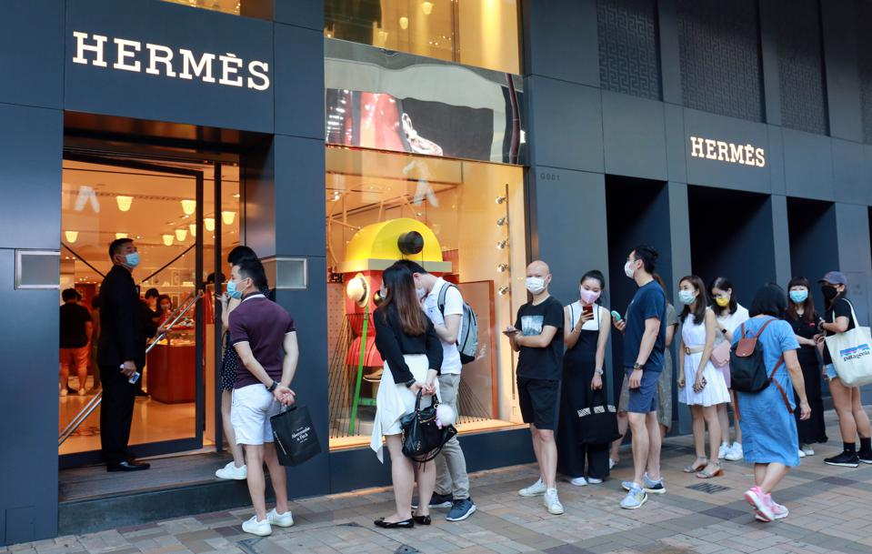 Typically a tourist hotspot, local shoppers are seen waiting in queues instead to shop for luxury goods.