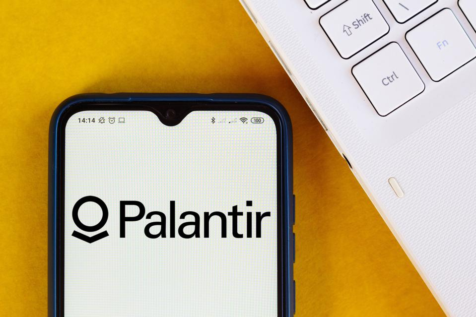 In this photo illustration the Palantir Technologies logo...