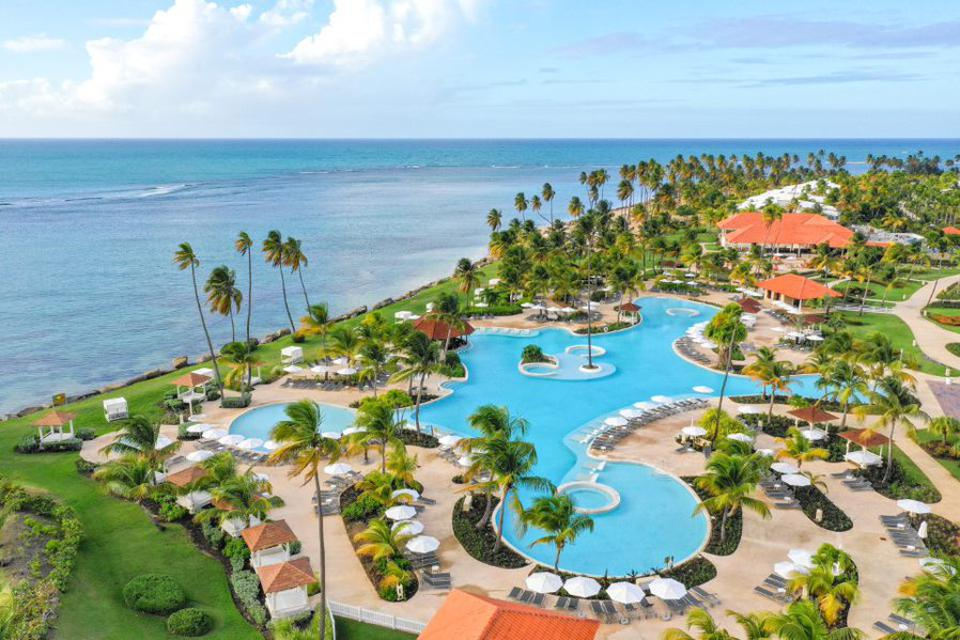 A pool and ocean near a resort in  Puerto Rico.