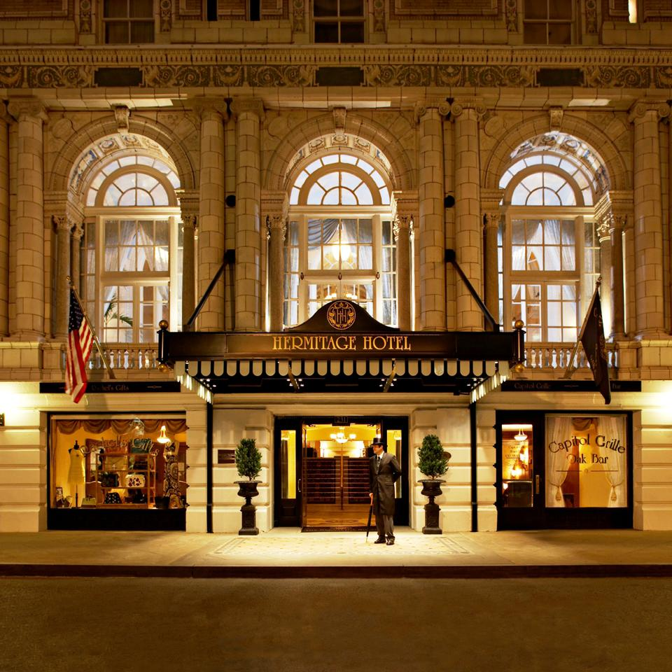 The exterior of the Hermitage Hotel at dusk.